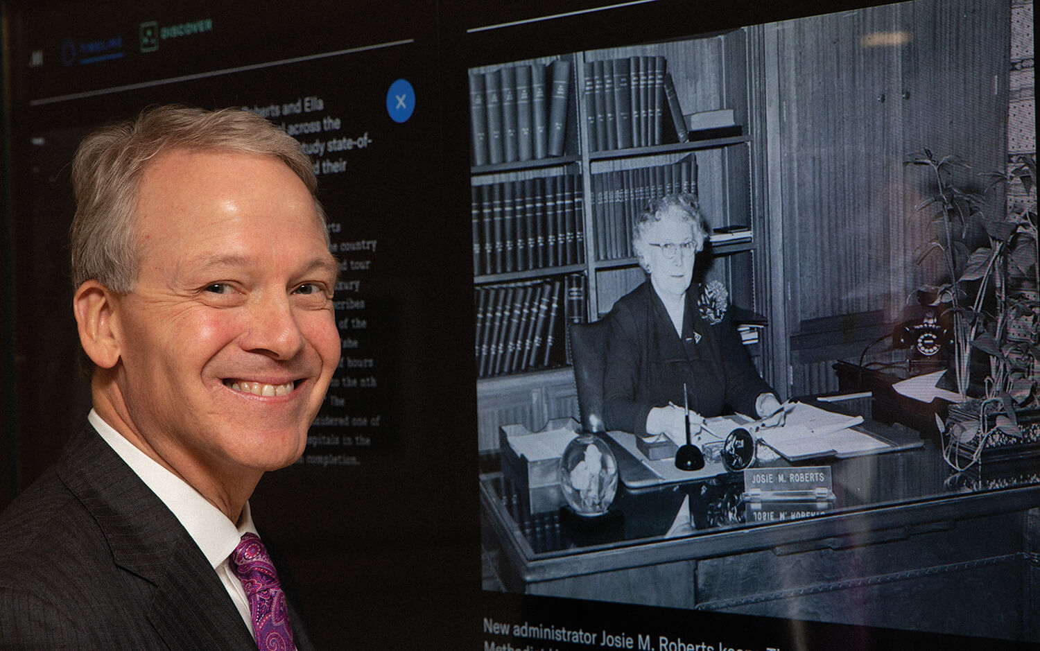 Marc Boom, M.D., current president and CEO of Houston Methodist Hospital, stands next to a photo of his predecessor, Josie Roberts.