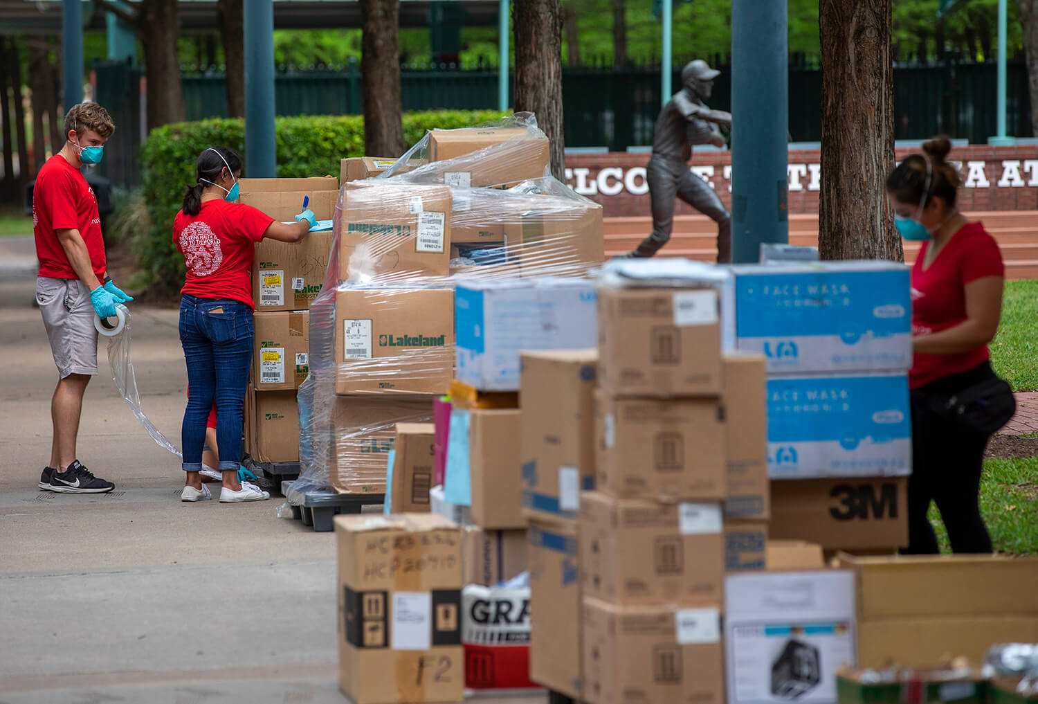 Project C.U.R.E. volunteers wrap up pallets of donated goods during a donation drive hosted by Mayor Sylvester Turner in partnership with Cheniere Energy, the Astros Foundation and Project C.U.R.E.