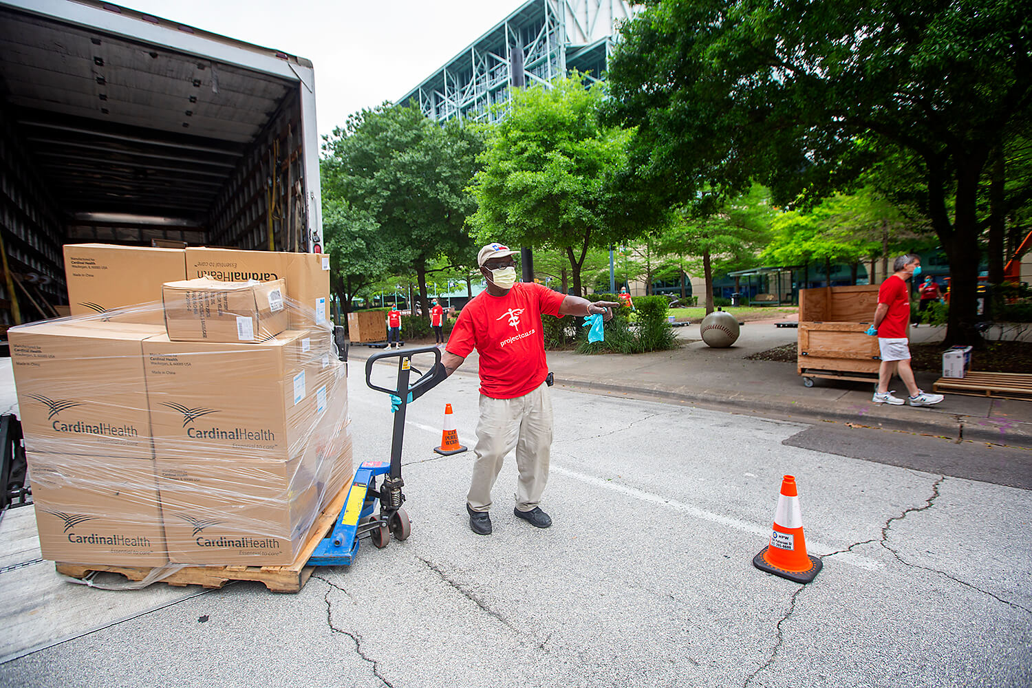 Project C.U.R.E volunteer Howard Amboree unloads pallets from a truck during the donation drive.