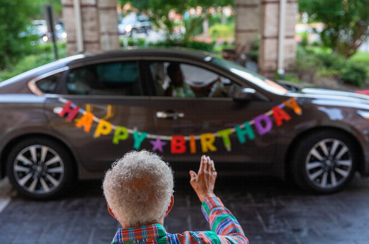 Robert L. Prater, Ed.D., a former dean at Texas Southern University, waves to family and friends as they celebrate his 90th birthday with a car parade at Memorial Hermann University Place, a senior community.