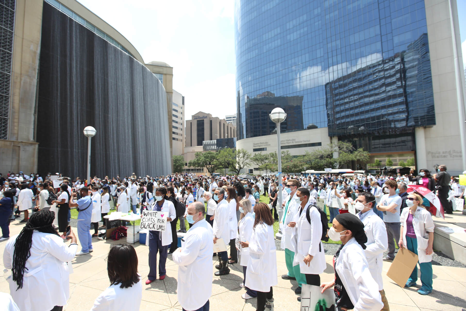 Texas Medical Center health professionals participate in a walking vigil for black lives on Tuesday, June 9, 2020.