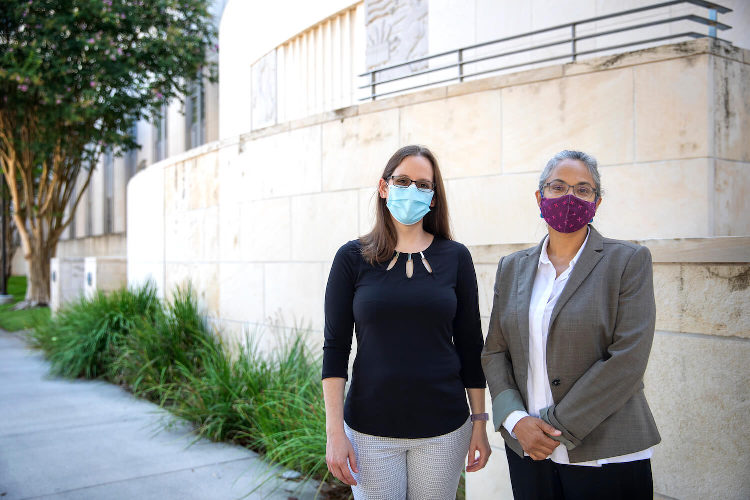 Medical ethicists Claire Horner, J.D., M.A., (left) and Savitri Fedson, M.D., M.A. outside Baylor College of Medicine.